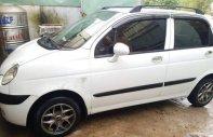 Cần bán gấp Daewoo Matiz SE đời 2004, màu trắng, giá tốt giá 90 triệu tại Tp.HCM