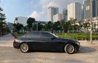 Cần bán xe BMW 3 Series 320 đời 2013, màu đen, xe nhập  giá 870 triệu tại Tp.HCM