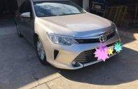 Bán Toyota Camry 2.0 năm 2016, màu vàng, giá tốt giá 895 triệu tại Hà Nội