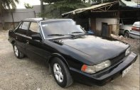 Cần bán gấp Mazda 626 đời 1986, màu đen, xe nhập còn mới giá 35 triệu tại Tp.HCM