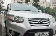 Cần bán Santa Fe Sx 2010 bản SLX, số tự động, máy dầu, màu bạc giá 670 triệu tại Hà Nội
