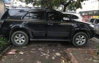 Bán Toyota Fortuner 2.7 V đời 2011, màu đen  giá 590 triệu tại Hà Nội
