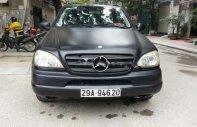 Cần bán gấp xe Mercedes ML320 sản xuất năm 2002, đăng ký lần đầu 2007, số tự động, máy xăng, màu đen giá 360 triệu tại Hà Nội