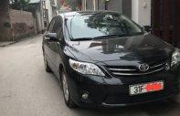 Bán Toyota Corolla altis 1.8 AT đời 2010, màu đen, chính chủ giá 550 triệu tại Hà Nội