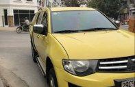 Bán xe Mitsubishi Triton đời 2011, màu vàng, nhập khẩu nguyên chiếc giá 325 triệu tại Hà Nội