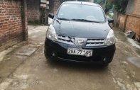 Cần bán Nissan Grand livina 1.8 MT đời 2010, màu đen   giá 285 triệu tại Hà Nội