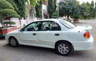 Cần bán xe Kia Spectra 1.6 MT đời 2003, màu trắng giá 130 triệu tại Ninh Thuận