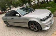 Bán BMW 3 Series 318i sản xuất năm 2004, màu bạc, nhập khẩu nguyên chiếc giá 350 triệu tại Hà Nội