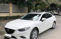 Cần bán Mazda 6 2.0AT 2016 màu trắng, odo 82.000 Km giá 707 triệu tại Tp.HCM