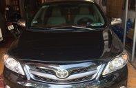 Cần bán xe Toyota Corolla Altis đăng ký lần đầu 28/12/2012, màu đen, hỗ trợ trả góp ngân hàng giá 560 triệu tại Bình Dương