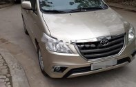 Bán gấp Toyota Innova 2.0E đời 2014, màu vàng còn mới, giá 515tr giá 515 triệu tại Hà Nội
