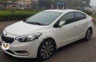 Cần bán Kia K3 1.6 AT 2014, màu trắng chính chủ, giá tốt giá 480 triệu tại Hà Nội