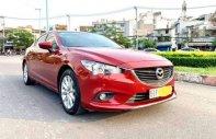 Cần bán Mazda 6 2.0AT 2014, màu đỏ, xe nhập chính chủ giá 670 triệu tại Tp.HCM