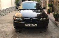 Cần bán BMW 318i sản xuất 2004, màu đen, số tự động giá 230 triệu tại Tp.HCM