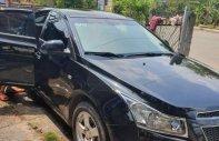 Cần bán lại xe Chevrolet Cruze đời 2011, màu đen giá 300 triệu tại Bình Dương