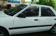 Cần bán xe Mazda 323 MT 1996, màu trắng, máy ngon, nội thất đẹp, trợ lực kính điện giá 39 triệu tại Phú Thọ
