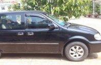Xe Kia Carnival GS 2.5 AT năm 2009, màu đen giá 330 triệu tại Tp.HCM