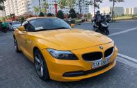 Cần bán gấp BMW Z4 model 2013 màu vàng nhập khẩu nguyên chiếc giá 1 tỷ 420 tr tại Tp.HCM