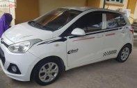 Gia đình cần bán Hyundai Grand i10 2014, màu trắng, xe nhập giá 240 triệu tại Phú Thọ