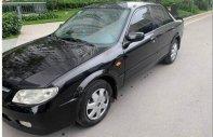 Cần bán xe Mazda 323 đời 2004, màu đen, xe gia đình giá 175 triệu tại Hà Nội
