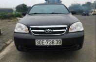 Bán xe cũ Daewoo Lacetti MT đời 2010, màu đen giá 220 triệu tại Hà Nội