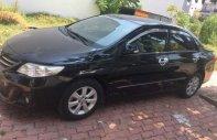 Cần bán Toyota Corolla 2011, màu đen, xe nhập đẹp như mới giá 580 triệu tại Tp.HCM
