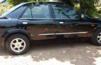Cần bán Mazda 323 Classic GLX năm sản xuất 2004, màu đen chính chủ, 199 triệu giá 199 triệu tại Quảng Bình