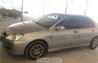Cần bán Mitsubishi Lancer GLX 1.6 AT sản xuất 2004, xe gia đình đang sử dụng chạy êm tốt giá 250 triệu tại Bình Định