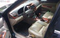 Bán Toyota Camry 2.4G năm sản xuất 2004, màu đen, số sàn  giá 307 triệu tại Tp.HCM
