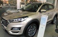 Bán xe Hyundai Tucson 2.0 AT đời 2019, màu vàng, giá 878tr giá 878 triệu tại Hà Nội