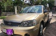 Cần bán lại xe Ford Laser 1.8 AT đời 2003, màu vàng, máy móc còn zin 100% giá 23 triệu tại Tp.HCM