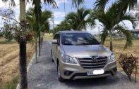 Chính chủ bán Toyota Innova đời 2014, màu vàng cát giá 560 triệu tại Khánh Hòa