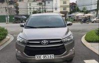Bán xe Toyota Innova 2.0E sản xuất cuối 2017, số sàn, màu đồng giá 678 triệu tại Hà Nội