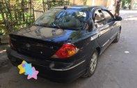 Cần bán Kia Spectra đời 2003, màu đen giá 105 triệu tại Hòa Bình