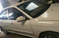 Bán gấp xe Kia Spectra đời 2004 màu trắng, xe đẹp giá 125 triệu tại Gia Lai