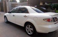 Cần bán lại xe Mazda 6 2.0 MT sản xuất năm 2004, màu trắng   giá 265 triệu tại Tp.HCM