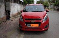 Gia đình cần bán Spark 2015 số tự động, màu đỏ, xe đi ít mới hơn 23000 km giá 285 triệu tại Nghệ An