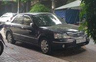 Bán xe Ford Laser GHIA 1.8 AT 2005, màu đen số tự động, giá tốt giá 240 triệu tại Tp.HCM