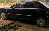 Bán ô tô Ford Laser đời 2005, màu đen xe gia đình giá 205 triệu tại Bình Phước