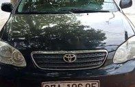 Gia đình bán Toyota Corolla altis sản xuất năm 2004, màu đen giá 230 triệu tại Nghệ An