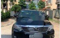 Bán Toyota Fortuner 2.7V năm sản xuất 2015, màu đen, chính chủ giá 730 triệu tại Hà Nội
