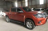 Chính chủ bán Toyota Hilux 2016, màu đỏ, nhập khẩu, số tự động 2 cầu giá 695 triệu tại Hà Nội