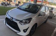 Toyota Wigo 1.2 MT, màu trắng, nhập khẩu nguyên chiếc, hỗ trợ vay 80%, thanh toán 110tr nhận ngay xe giá 330 triệu tại Tp.HCM