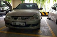 Cần bán Mitsubishi Lancer sản xuất 2005, màu vàng cát, giá tốt giá 240 triệu tại Tp.HCM