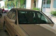 Cần bán lại xe Mitsubishi Lancer đời 2004, màu vàng xe gia đình, giá chỉ 230 triệu giá 230 triệu tại Đà Nẵng