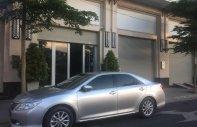 Gia đình bán Toyota Camry 2.0E đời 2013, màu bạc, nhập khẩu giá 700 triệu tại Tp.HCM