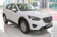 Bán ô tô Mazda CX 5 sản xuất năm 2015, màu trắng, xe nhập, 650 triệu giá 650 triệu tại Tp.HCM