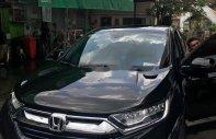 Bán Honda CR V 2018, màu đen, nhập khẩu, nhà sử dụng kĩ nên còn rất mới giá 1 tỷ 35 tr tại Tp.HCM