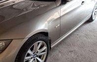 Chính chủ bán xe BMW 320i năm 2010, màu vàng cát, nhập khẩu giá 515 triệu tại Hà Nội