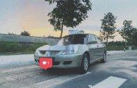 Cần bán Mitsubishi Lancer AT 2004, màu bạc số tự động, giá chỉ 210 triệu giá 210 triệu tại Bình Dương